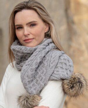 Cable knit pom pom scarf